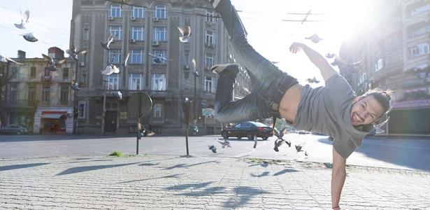 young man doing street dance, feeling happy and energetic.