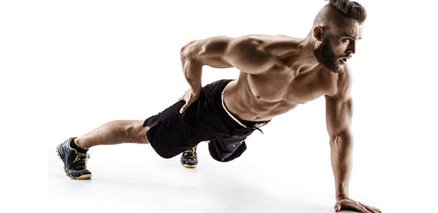 attractive man doing push-ups exercises from the floor on the left arm. photo muscular man isolated on white background. the strength and motivation